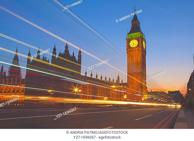 Traffic blur in front of Big Ben at sunset