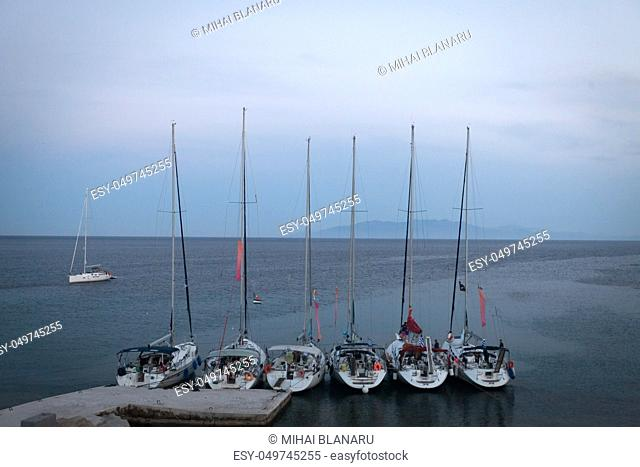 Few small yachts anchored on a small raft
