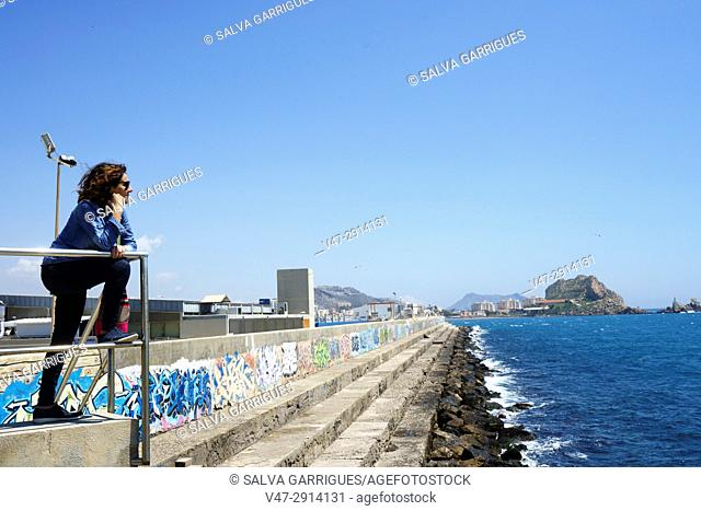 A woman looking at the sea in the lighthouse of Aguilas, Murcia, Spain
