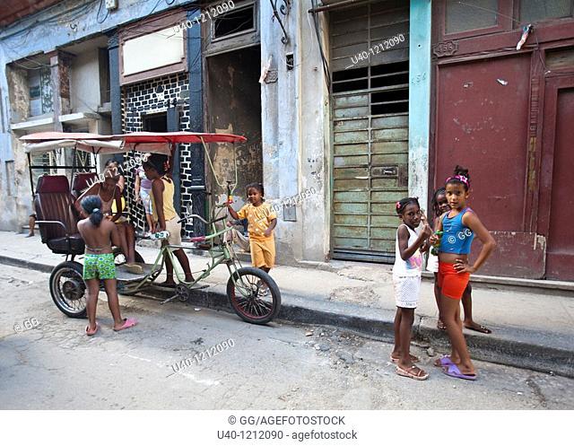 Cuba, Havana Vieja, children playing on the street
