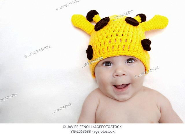 Baby girl in giraffe hat