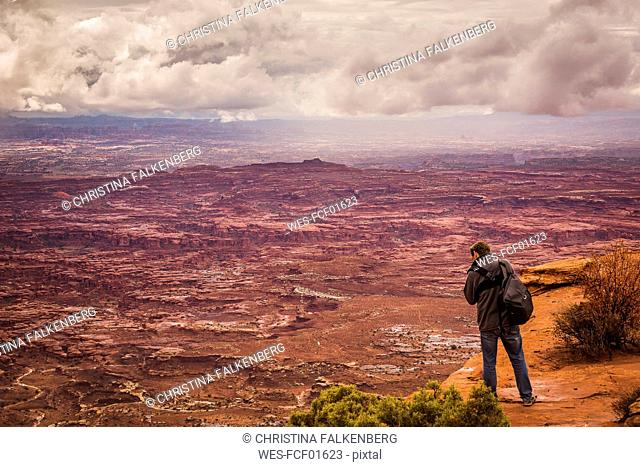 USA, Utah, Canyonlands National Park, The Needles, man on viewpoint photographing