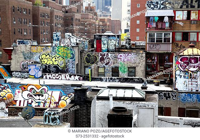 Rooftops in the New York neighborhood of Chinatown are covered with graffiti, Manhattan, New York, USA