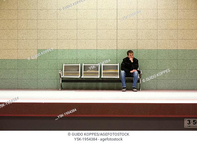 Sofia, Bulgaria. Commuter waiting for a train to arrive in Han Kubrat, a down town subway station. He is one of the few