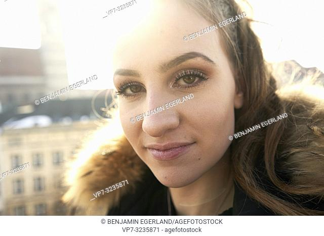headshot of young woman outdoors next to Marienkirche, Frauenkirche, in Munich, Germany