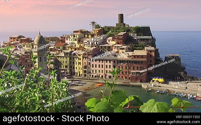 Pan across harbour of the fishing village of Vernazza at sunrise, Cinque Terre National Park, Liguria Riviera, Italy. A UNESCO World Heritage Site
