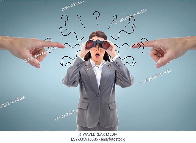 Hands pointing at excited business woman looking through binoculars against blue background with que