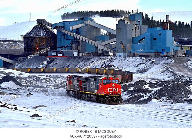 A Canadian National Railway train loading coal from a processing plant at a coal mine near Cadomin Alberta