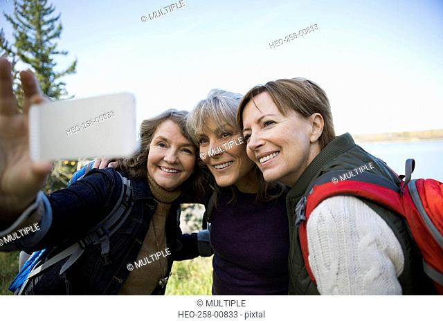 Friends hiking taking selfie with camera phone