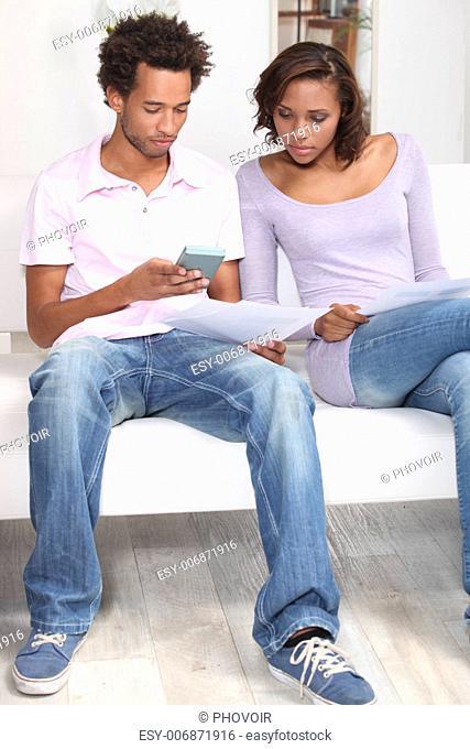 Couple fixing a budget