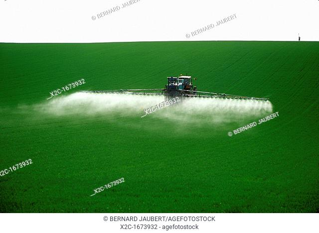 Spraying fertilizer on crops . France
