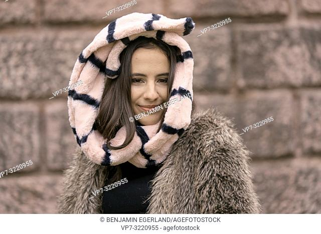 vital content woman head enveloped in scarf, playful positive, cold temperatures, happiness, in Munich, Germany