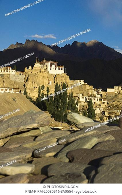 Close-up of stones with a monastery in the background, Lamayuru Monastery, Ladakh, Jammu and Kashmir, India