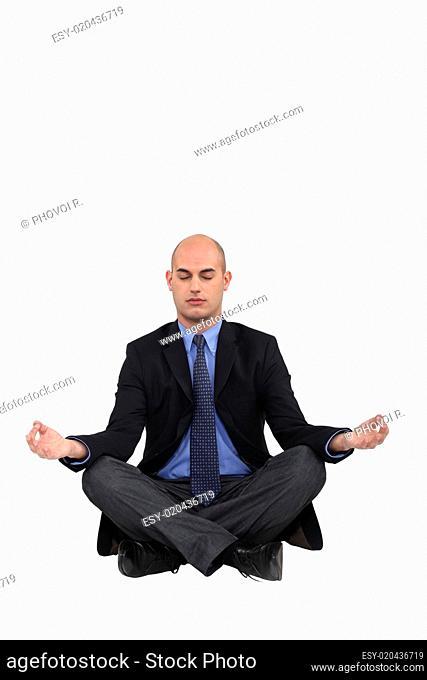 Businessman in a yoga position