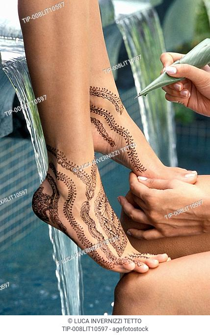 Mehndi, a temporary tattoo with henna dye applied to hands and feet on festive occasions in India