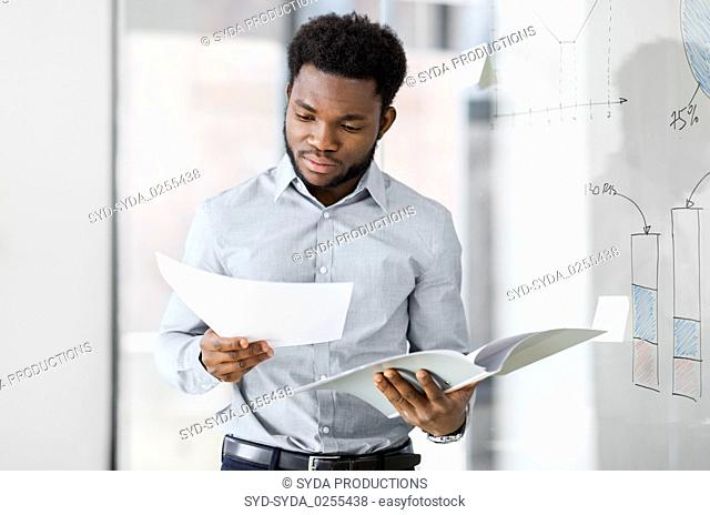 african american businessman with folder at office