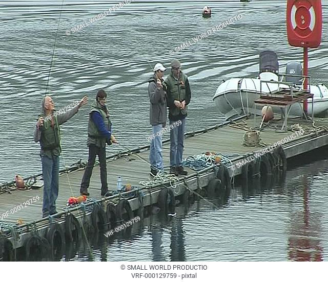 Men angling on jetty, South Wales
