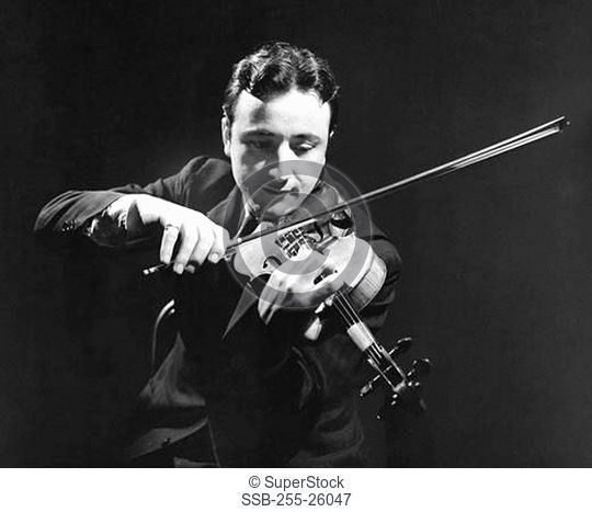 Mid adult man playing a violin