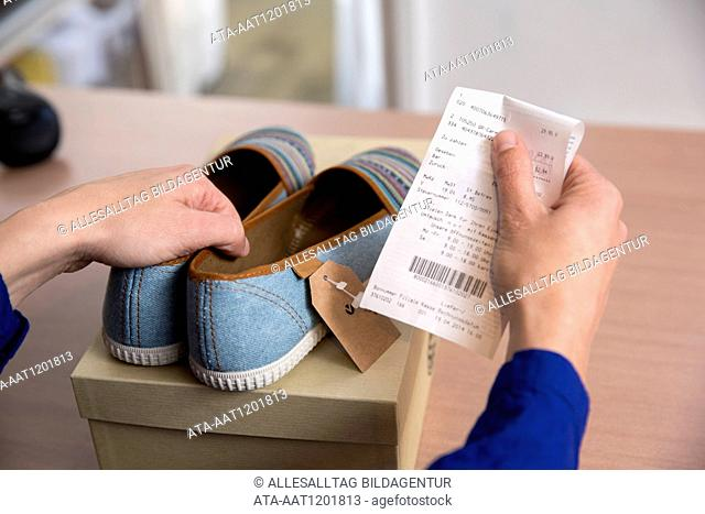 Woman is returning shoes in a boutique
