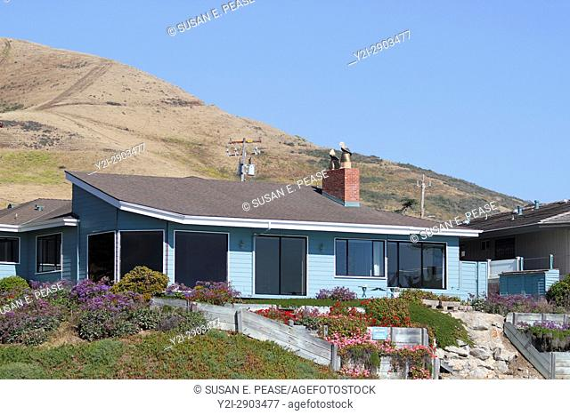 A home on the beach near the town of Morro Bay, San Luis Obispo County, California, United States. Editorial use only