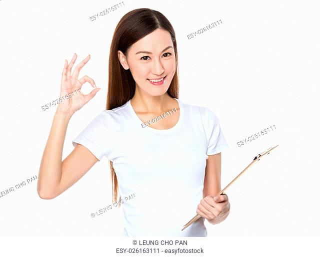 Asian Young Woman hold with clipboard and ok sign gesture