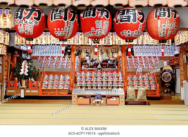 Offerings on the altar of a Japanese Shinto shrine at Fushimi Inari Taisha shrine in Kyoto, Japan