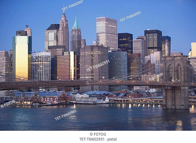 USA, New York state, New York city, Brooklyn Bridge with skyscrapers at night
