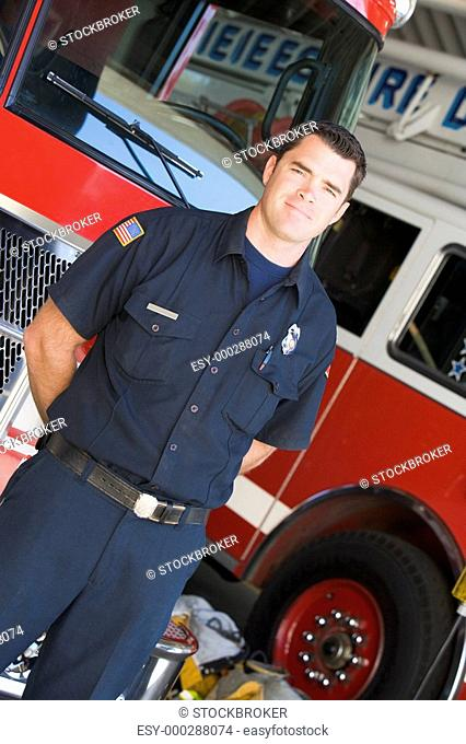Fireman standing in front of fire engines