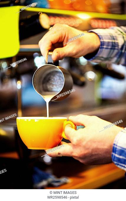 Close up of a barista making a cup of espresso