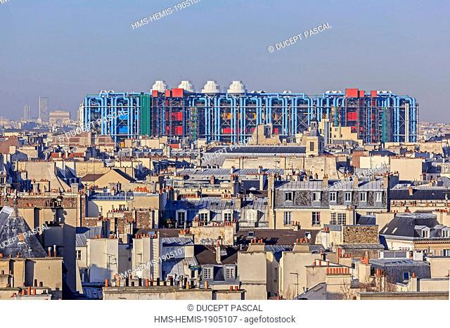 France, Paris, the Pompidou Center also called Beaubourg Center by the architects Renzo Piano, Richard Rogers and Gianfranco Franchini and the Parisian rooftops