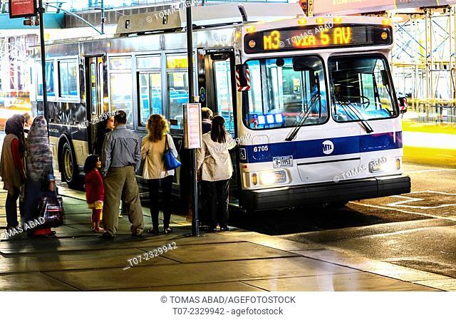 MTA Buses during evening, rush hour traffic, public transportation, Mass Transit, Midtown Manhattan, 42nd Street, 5th Avenue, New York City, USA