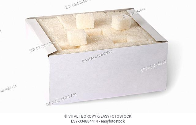 White sugar cubes in a box top view isolated on white background