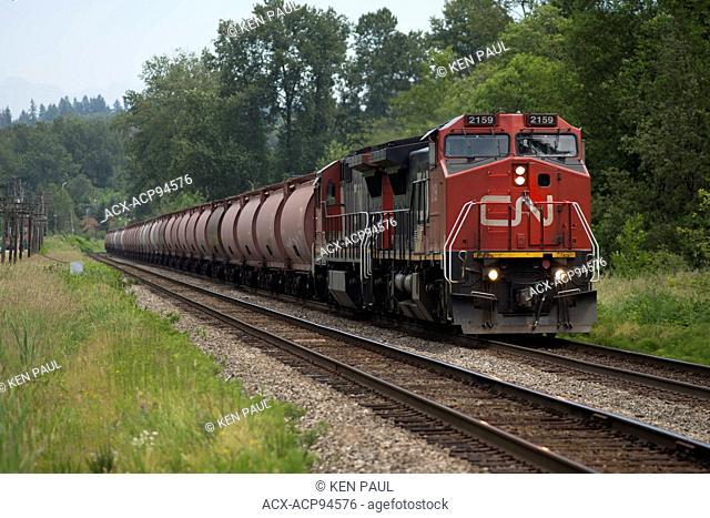 CN (Canadian National) train travels through Burnaby, British Columbia, Canada