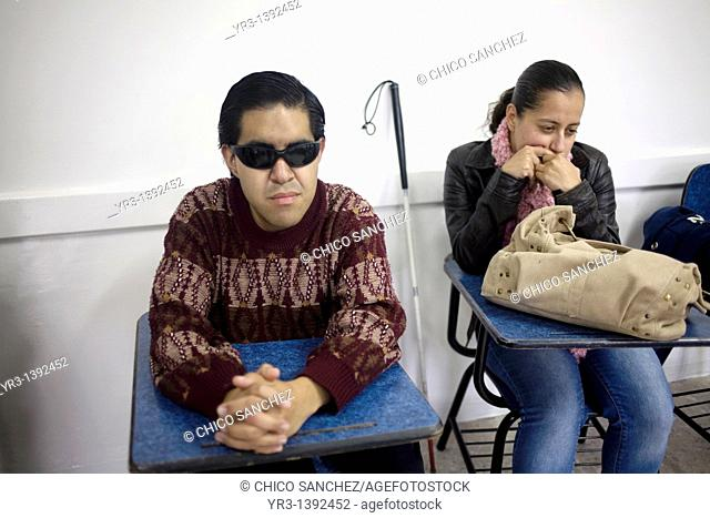 Blind students sit in class