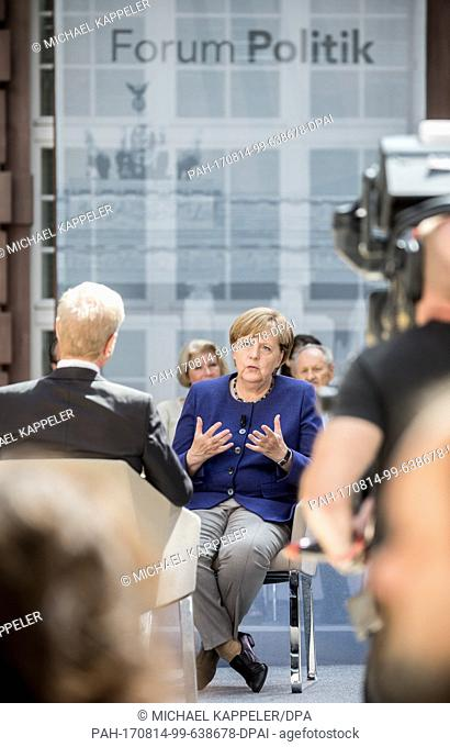 "German Chancellor Angela Merkel speaking with journalist Michael Hirz during the recording of the TV program """"Forum Politik"""" of the Phonix broadcaster in..."