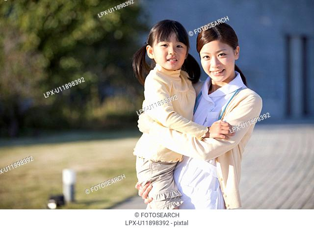 Young Female Nurse and Girl