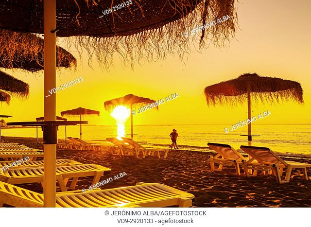 Beach hammocks at sunrise, Benalmadena. Malaga province Costa del Sol. Andalusia Southern Spain, Europe