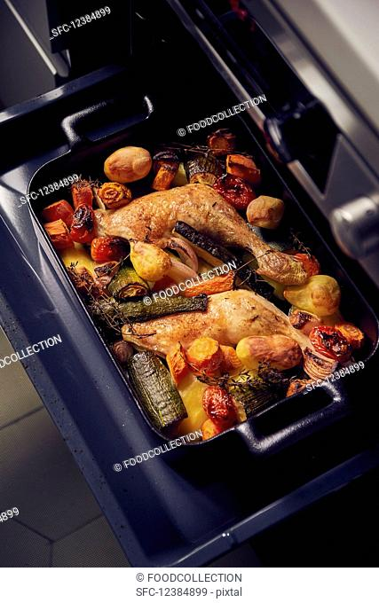 Chicken legs with vegetables fresh from the oven
