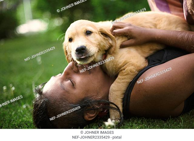 Woman playing with puppy
