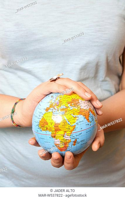 man hands holding earth