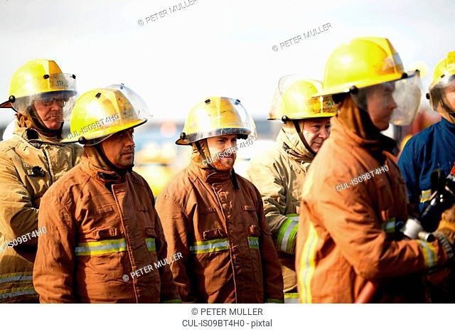 Firemen training, group of firemen listening to instructions