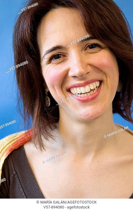 Woman smiling and looking at the camera. Close view