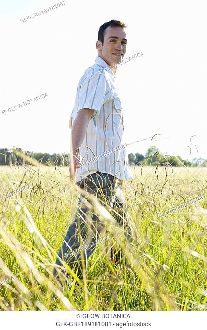 Man walking in a grassland