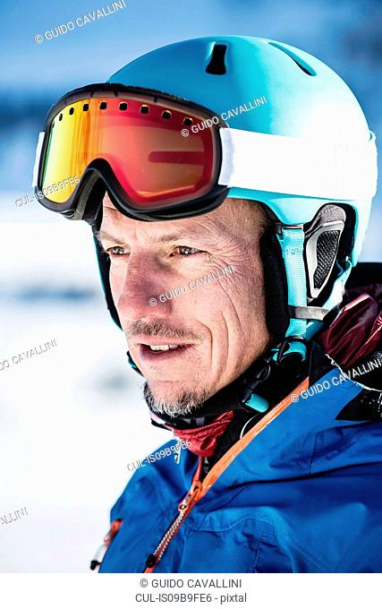 Portrait of skier, outdoors, close-up