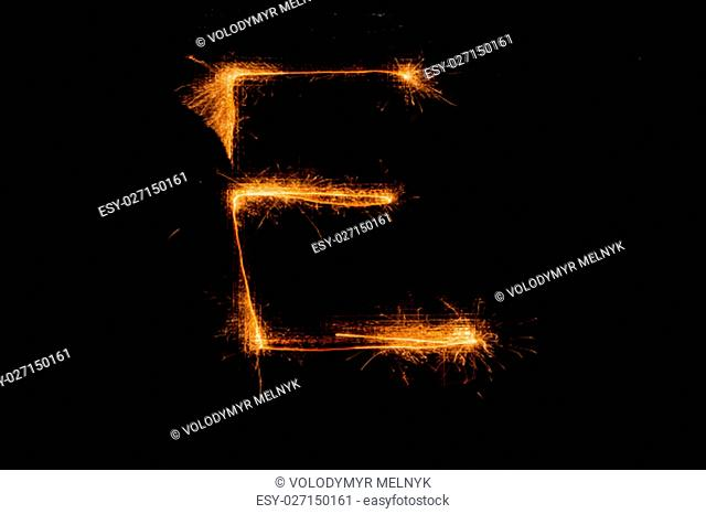 The English letter E made of sparklers on black background
