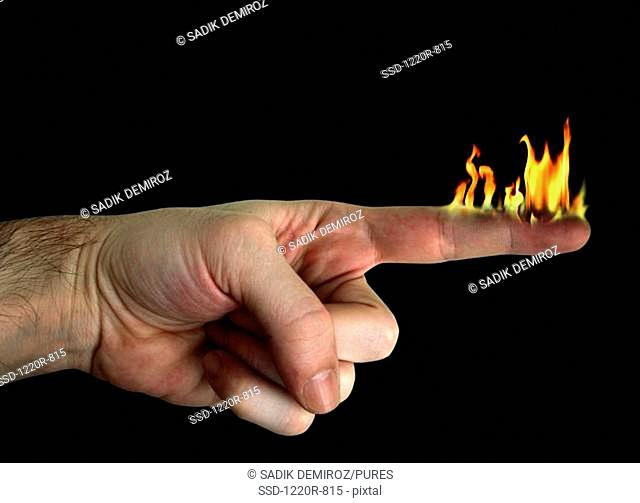 Person's finger on fire