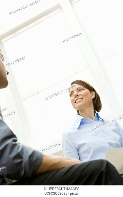 Businesswoman looking at coworker