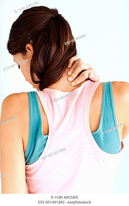 Rear view of young woman having neck ache