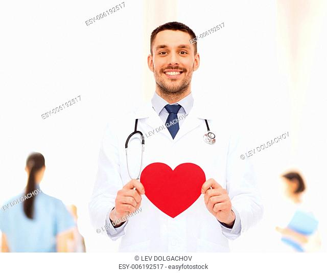medicine, profession, and healthcare concept - smiling male doctor with red heart and stethoscope