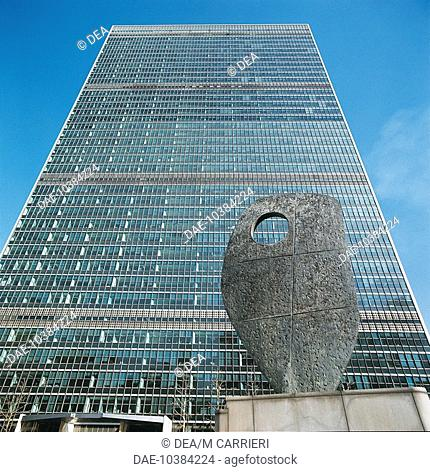 Low angle view of a sculpture in front of a government building, United Nations Building, New York City, New York State, USA